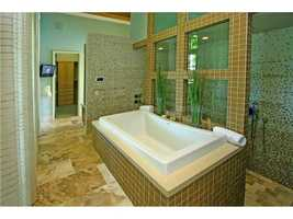 The master bathroom features a spa tub.