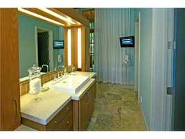 The master bathroom also includes dual vanity areas.
