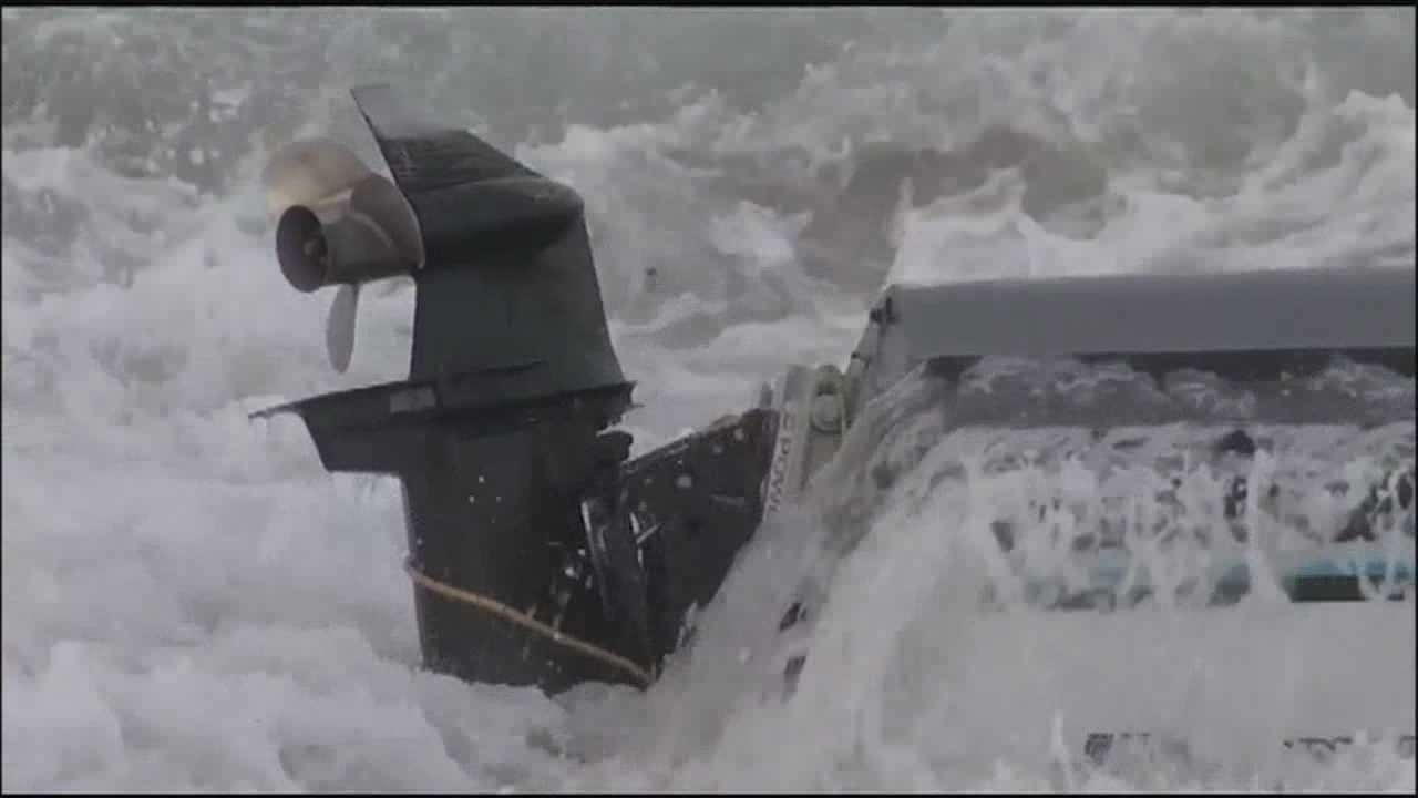 Man rescues daughter after boat flips