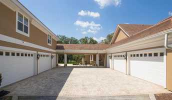 There are a total of 10 garages, 7 carports and an AC garage with workshop, office and half bath.