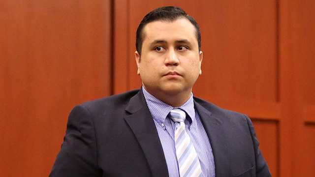 Zimmerman getting our of chair February.jpg