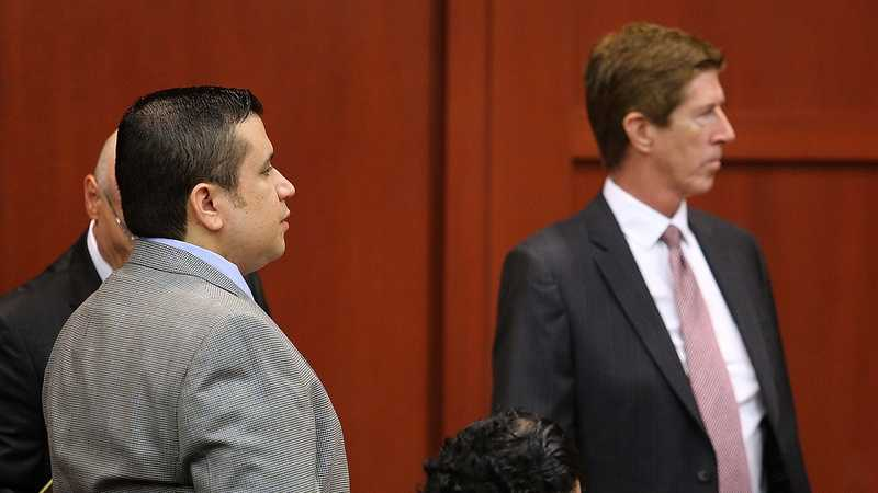 George Zimmerman answers questions posed by Judge Debra Nelson, with defense attorney Mark O'Mara (right) co-counsel Don West (behind Zimmerman), and jury consultant Robert Hirschhorn (bottom), Wednesday, June 12, 2013. Zimmerman is accused in the fatal shooting of Trayvon Martin. (Joe Burbank/Orlando Sentinel)