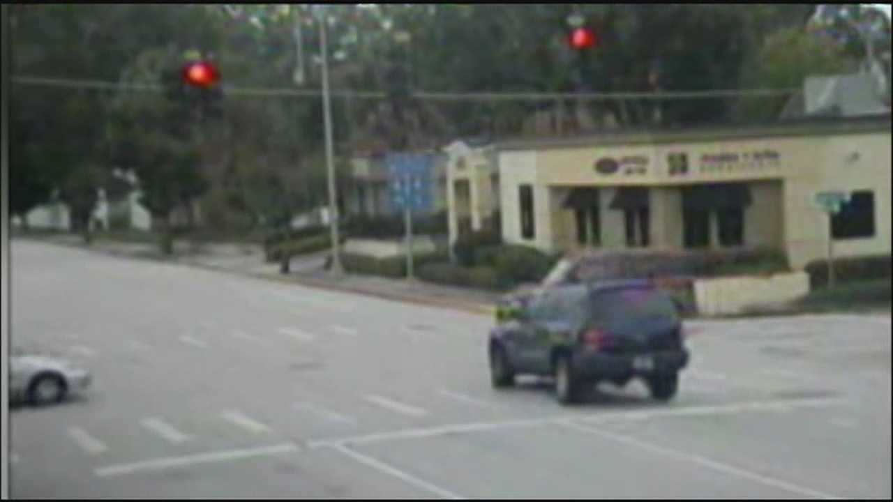 A bill signed by Gov. Rick Scott may make it more difficult to fight red-light tickets.