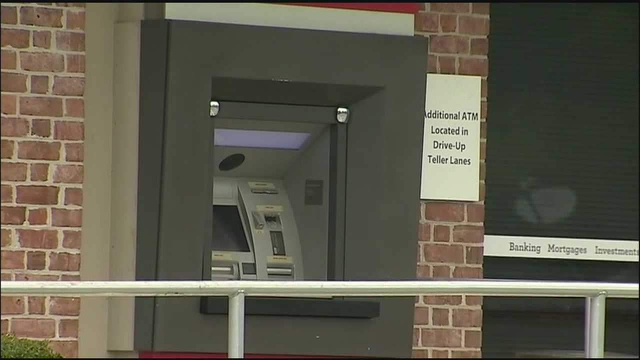 Daytona Beach police officers say a thief threatened a bank patron with a gun overnight.