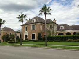 This elegant 6 bedroom, 8 bathroom home in Celebration, Fl is formal on the outside and luxurious on in the inside. Take a tour of the $4.8 million home.