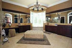 Master bathroom is filled with luxury, featuring a XL-jet circular tub, dual water closets,& walk in shower.