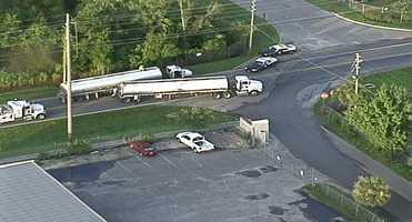A crash involving a semi-truck and an SUV has shut down an Orange County road.