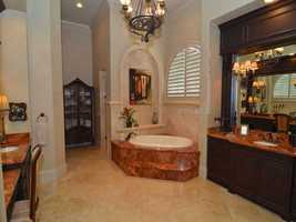 Master suite includes a tranquil bathroom.