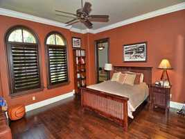 This quaint bedroom features custom blinds.