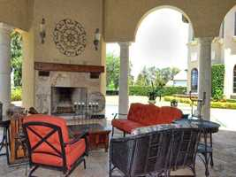 Outdoor seating with a beautiful fireplace.