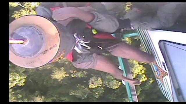 Raw video: Rescuers pull stranded man into helicopter