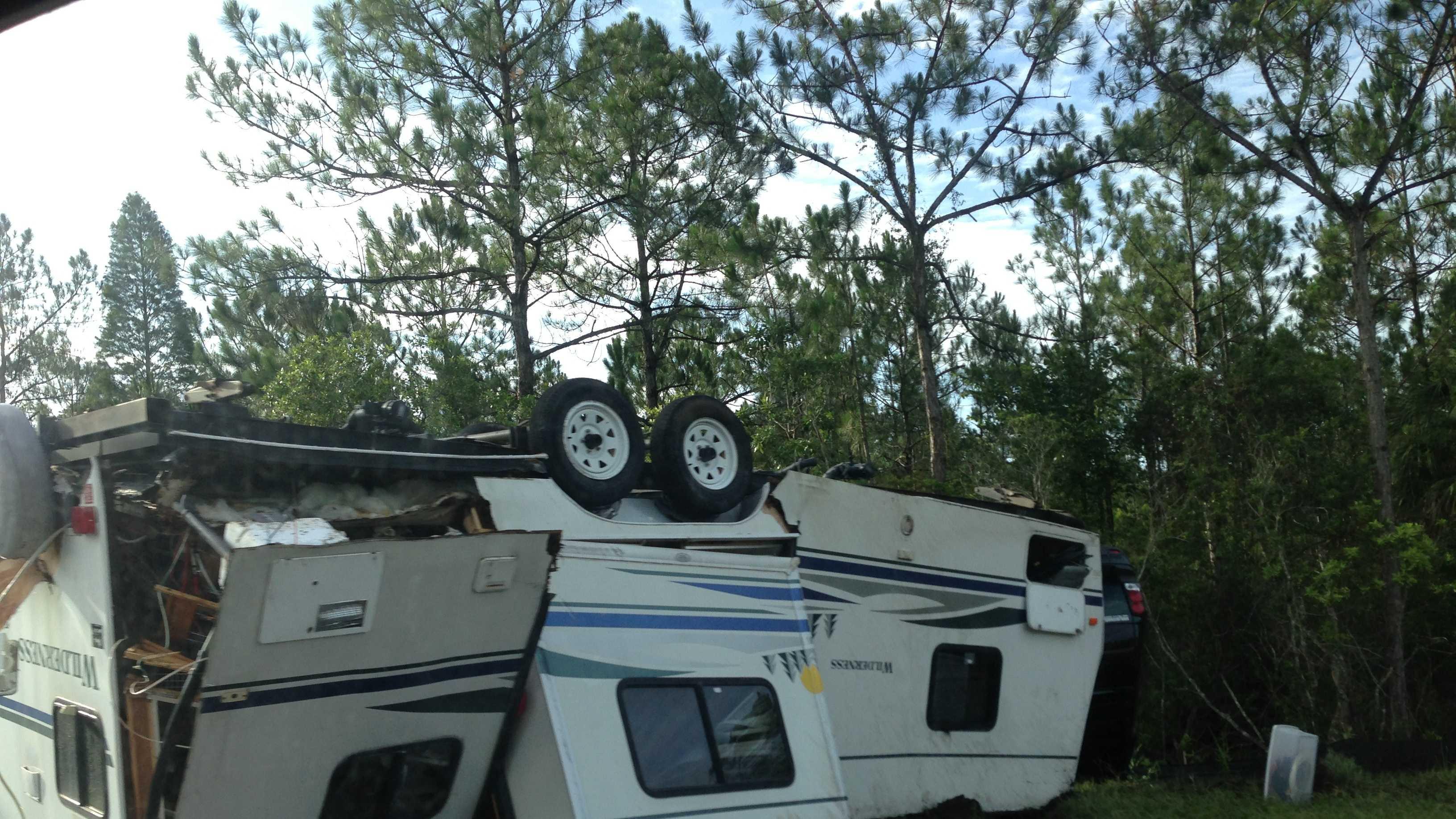 Camper turns over - u local