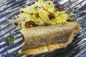 Seared trout with Frisee, Bacon and Maple Minus 8 Vinaigarette debuts at the Canada Marketplace in 2013.