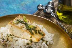 Guests can enjoy Seared Mahi Mahi with Jasmine Rice and Singa Sauce at the Singapore Marketplace.