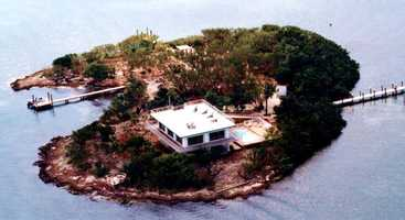 Enjoy they two-story, three-bedroom home on the island with running water and electric and phone service.