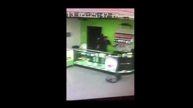 Raw Video: Robber makes off with cash, 15 cellphones