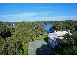 This aerial view of the 0.93 acre property shows the tennis court.