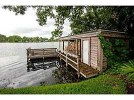 Covered dock w/electric hoist.