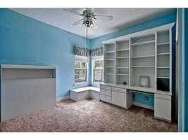 Intricate shelving/desk unit in this upstairs room perfect for a child.