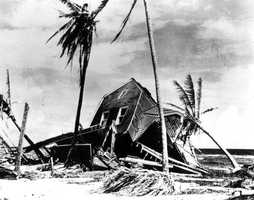 1926: A home along the beach in Miami is damaged during a hurricane.