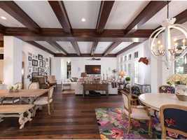Wooden beams extend from the kitchen to the family room.