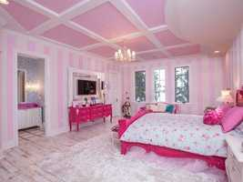 This children's room is the epitome of pretty and pink. It features beautiful windows overlooking the lake view and a private bathroom.