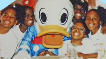 The Gaithers pose with Donald Duck for their 10th birthday in 1993.