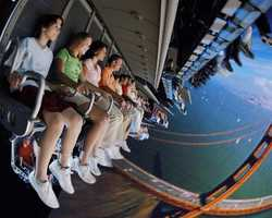 """Soarin': Experience California like never before while """"hang-gliding"""" over landscapes as varied as they are beautiful. Feel like you're flying—and even smell what you're seeing as you skim rolling waves, powdery ski slopes, majestic redwood forests, fragrant orange groves and familiar landmarks such as the Golden Gate Bridge."""