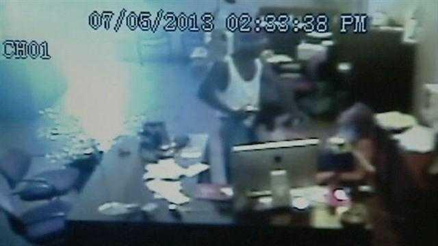 Surveillance video: Man holds gun to child's head, pistol-whips woman