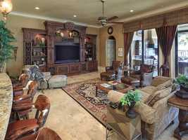 The kitchen opens into a spacious family room.