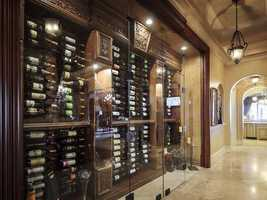 The wine rack is encased in glass and can hold up to 1,000 bottles.