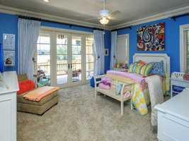 The home features five other bedrooms -- this one has its own balcony.