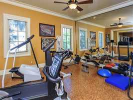 A spacious home gym makes working out convenient.