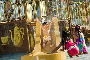 "2. ""Alice In Wonderland"" Water Play Area at Disney's Grand Floridian Resort & Spa - Features: Overflowing water teacups, the Mad Hatter's hat, small water hoses"