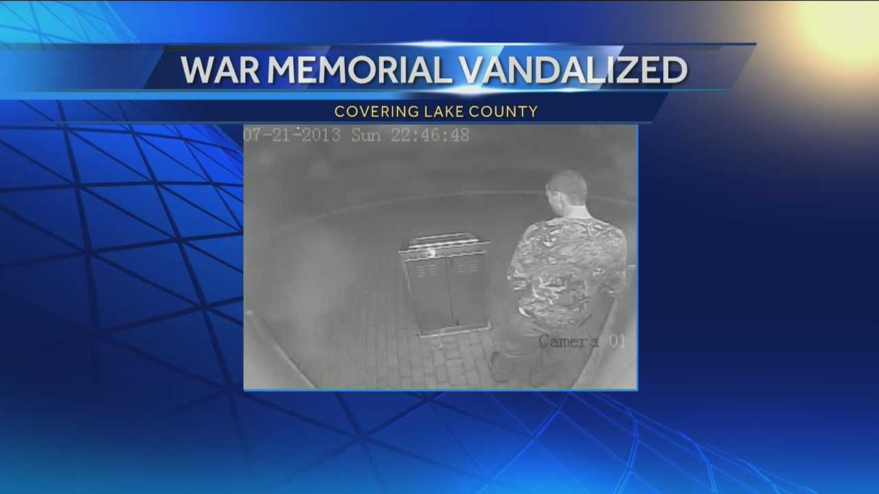 Surveillance shows man vandalizing war memorial