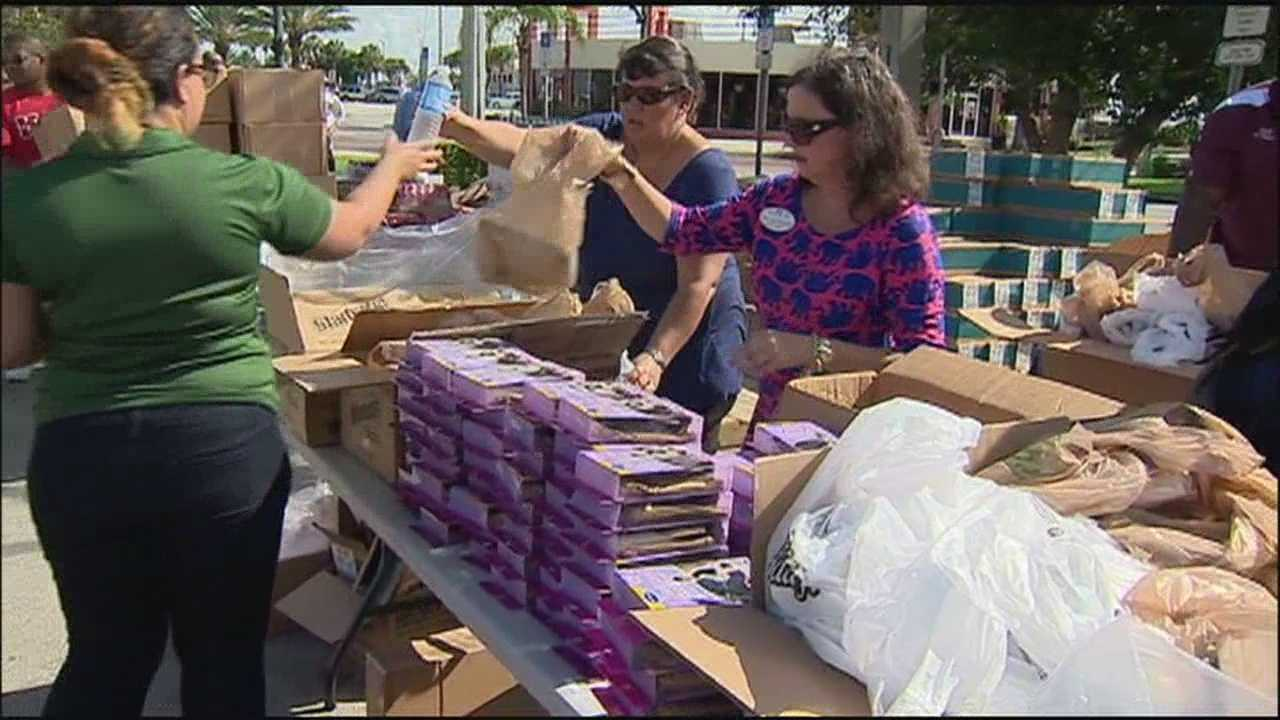 Five hundred Sanford families in need of assistance lined up for free Farm Fresh groceries Saturday.