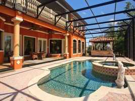 Saltwater pool has twin fountains, a paver deck and large Gazebo with a granite summer kitchen.