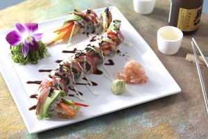 Dragon roll: Tempura shrimp, marinated tuna, seared tuna wasabi cream and spicy teriyaki
