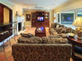 The family room has great views of the pool and lake.