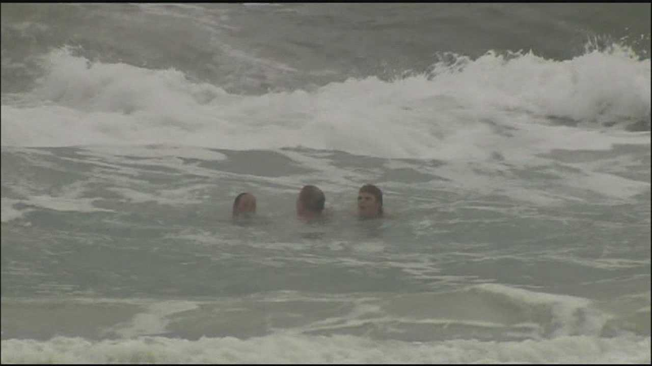 Hotel employees help save man struggling in rough surf