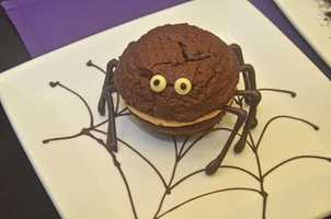 Guests can grab a peanut butter chocolate spider whoopie pie at Tony's Town Square Restaurant.  The chocolate bat cake is also available, but during dinner on party nights only.