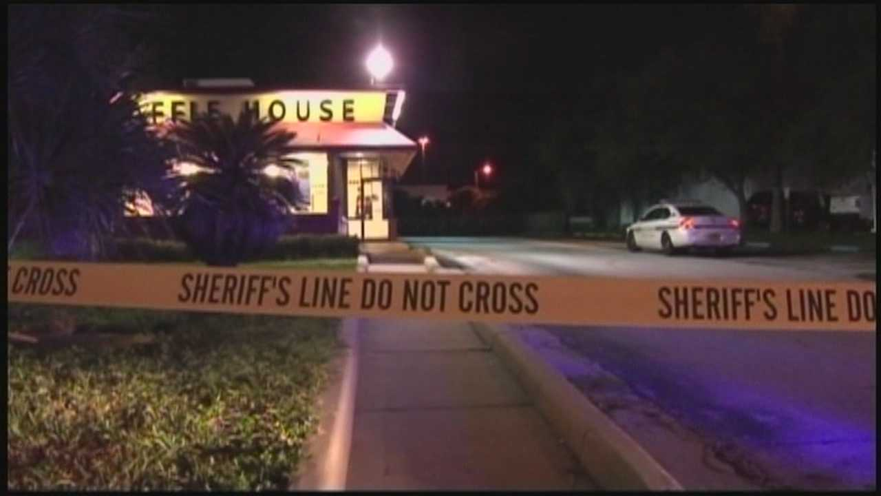 Orange County deputies are searching an armed man who robbed a restaurant at gunpoint.