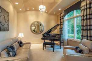 Elegant den area alongside the ground floor master suite.