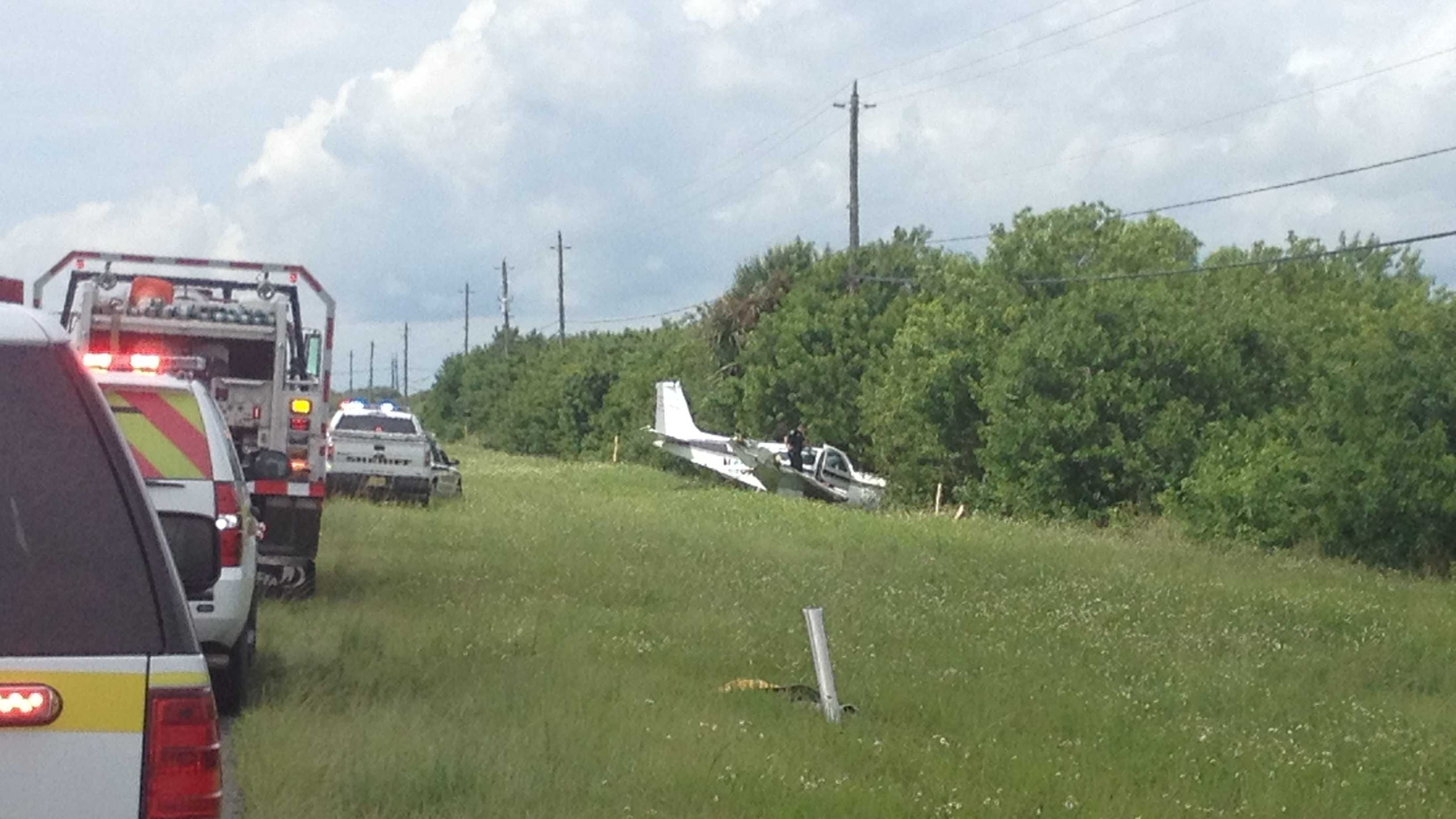 small plane crashes in grass