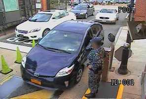 The Federal Bureau of Investigation has released surveillance images and evidence images from the Washington Navy Yard shooting. This photo shows Aaron Alexis drive his rental car through the Washington Navy Yard main gate. See video here
