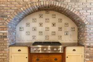 Close up of the brick arch above the stove.