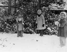 Children playing in the snow within the Indian Head Acres development in Tallahassee, Florida. Photograph taken in 1957 or 1958.