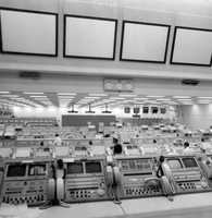The vast control room and employees inside of the space station.  Photograph taken in 1972.