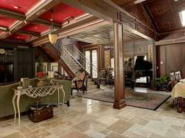 The home features imported old-world Turkish stone flooring, wood detail and hand-painted acanthus crown molding.