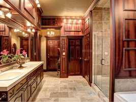 Upstairs is a spacious master retreat with oversized master bathroom featuring more spectacular wood detailing.